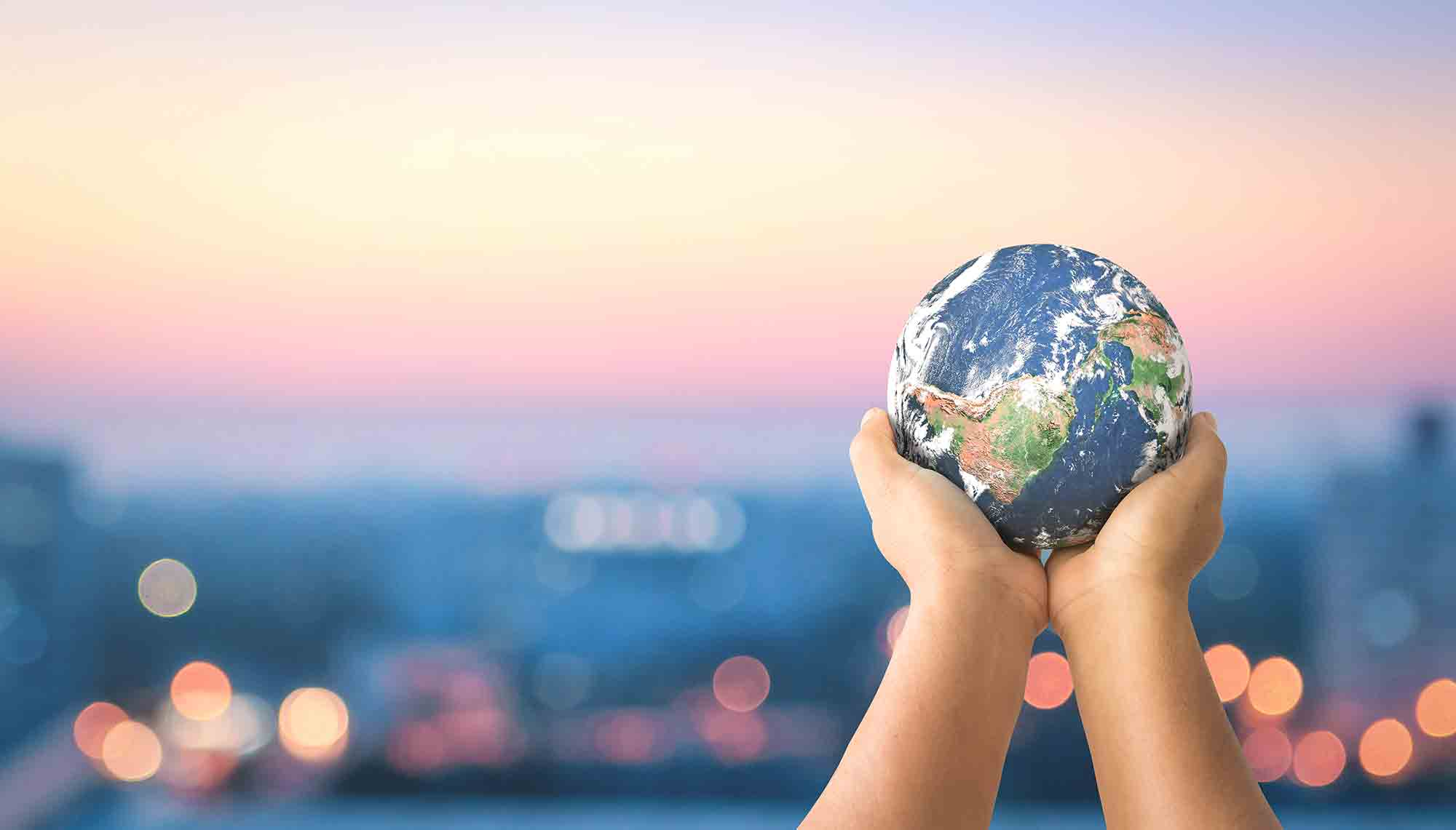 hands holding a globe sustainable great responsibility