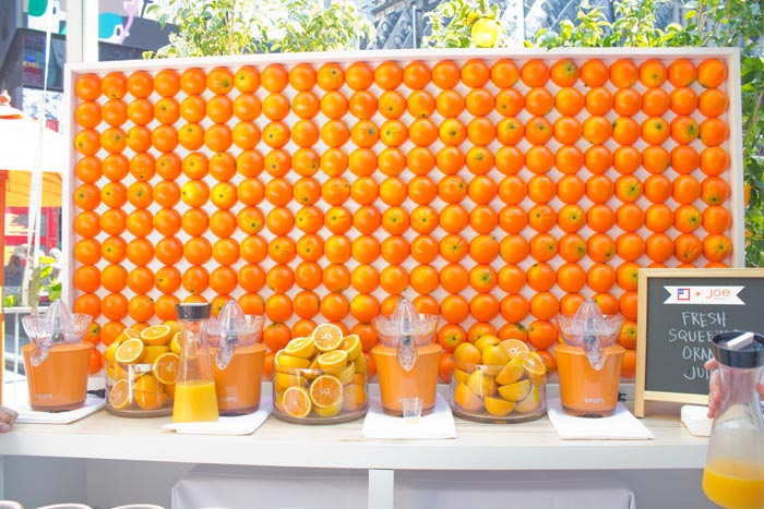 Orange Wall added texture and served as the backdrop to the bar where staff poured complimentary cups of freshly squeezed orange juice.