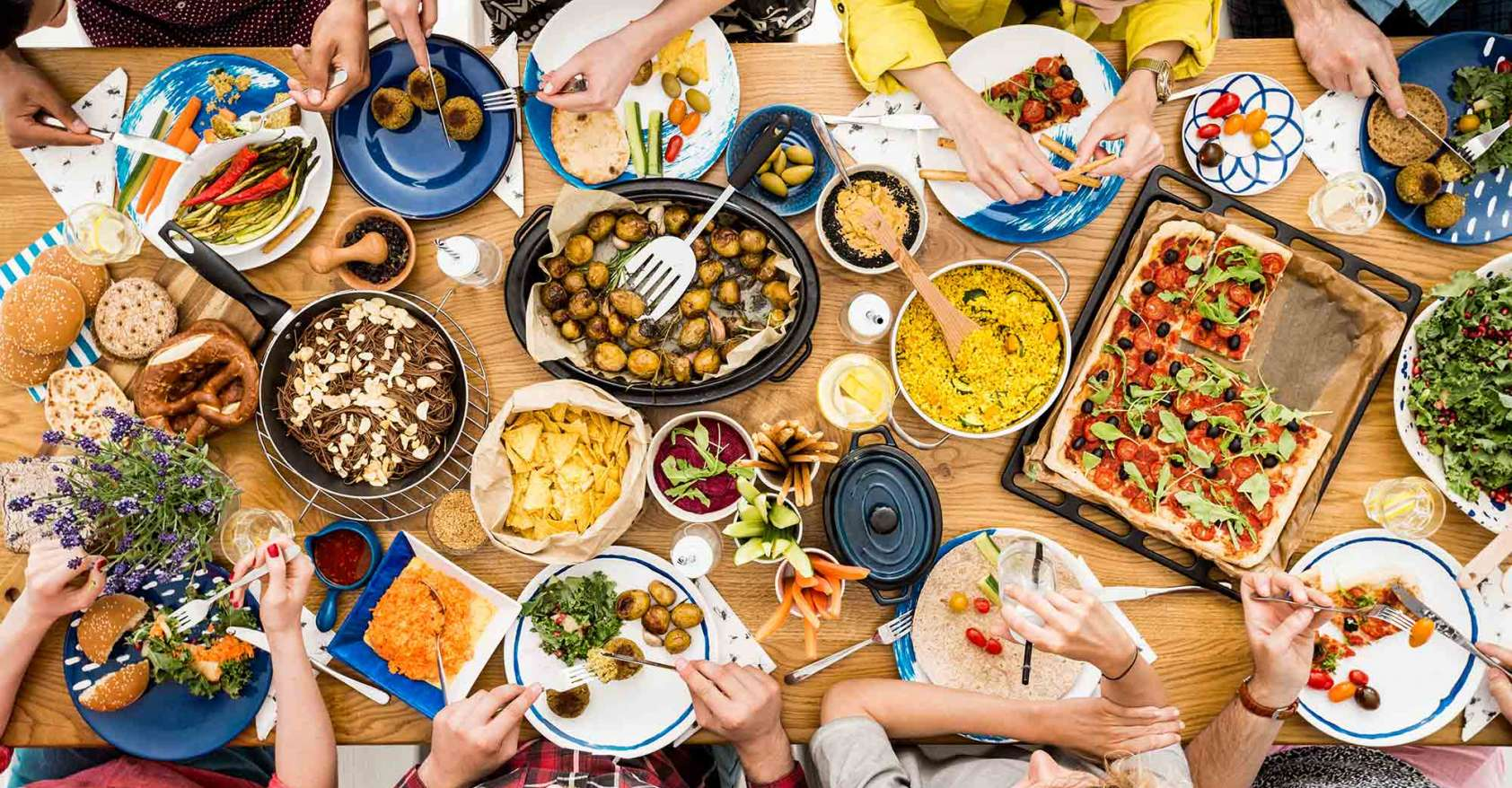 group of people at table eating vegetarian/vegan options