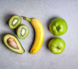 apple, banana, avocado, kiwi in gray background latex allergies