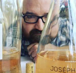 Man in glasses looking at beer carafes non-alcohol beverages
