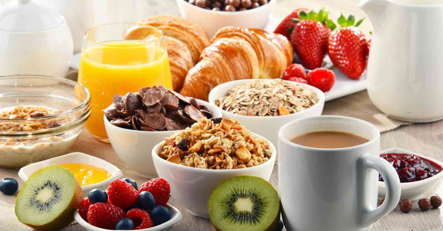 healthy breakfast fruit, coffee, croissant, oatmeal, heart-healthy