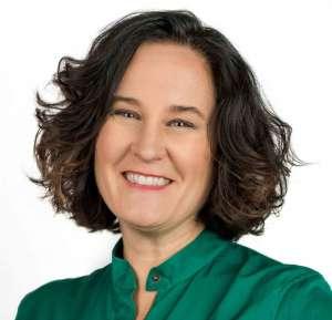 Tracy Stuckrath headshot green blouse