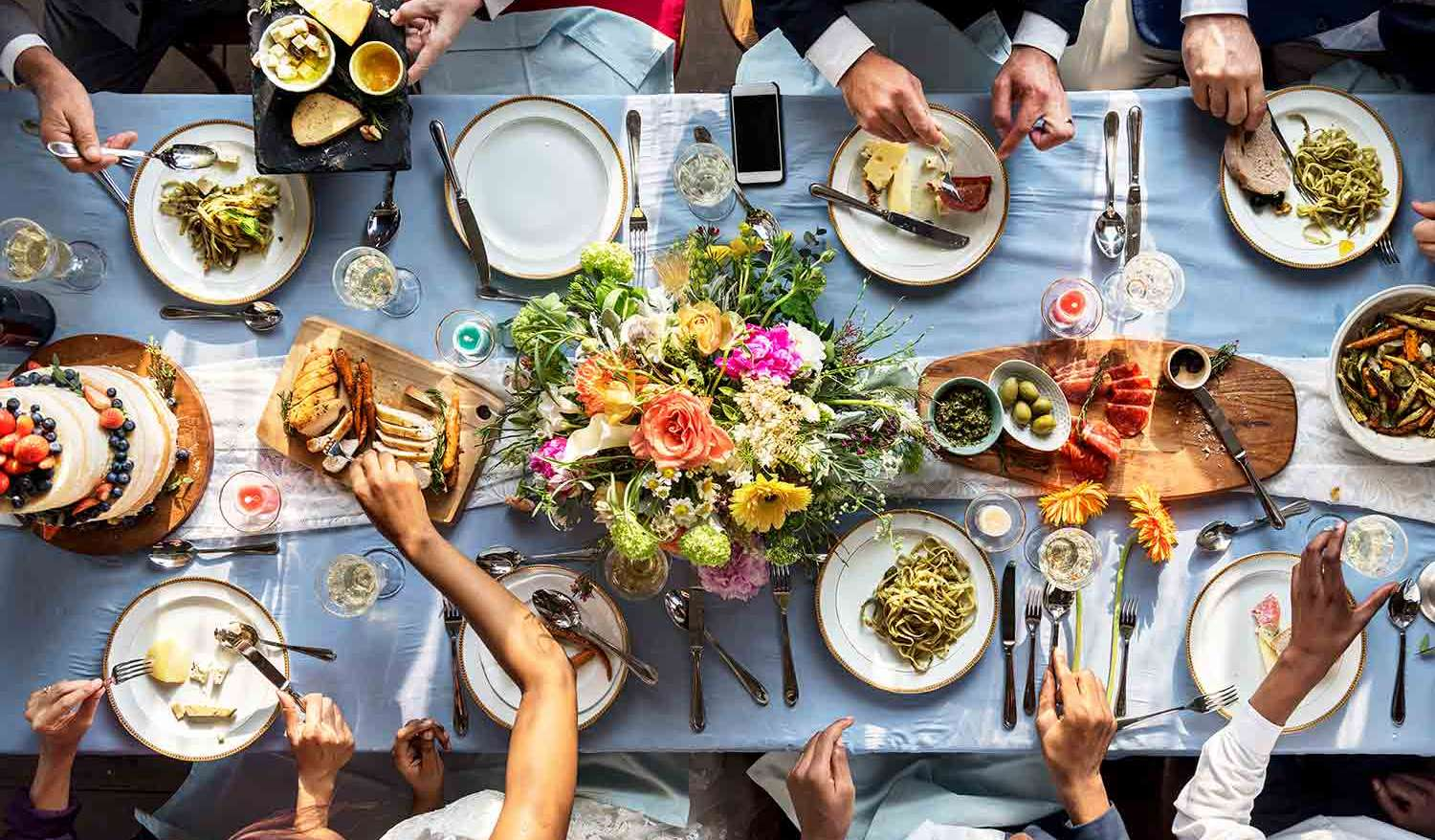 Diverse Group of People Eating at a Table share your story