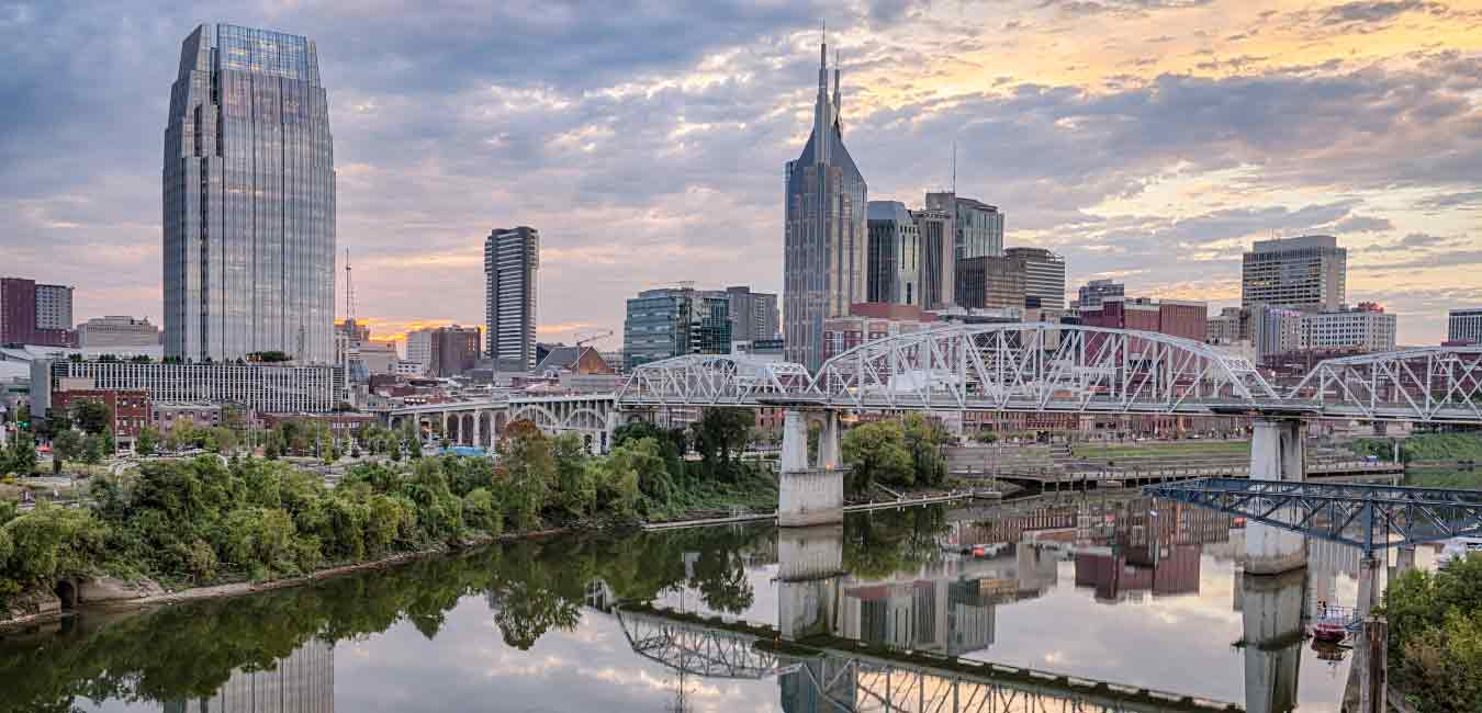 Nashville skyline looking across the river. Committed to community Dee Patel
