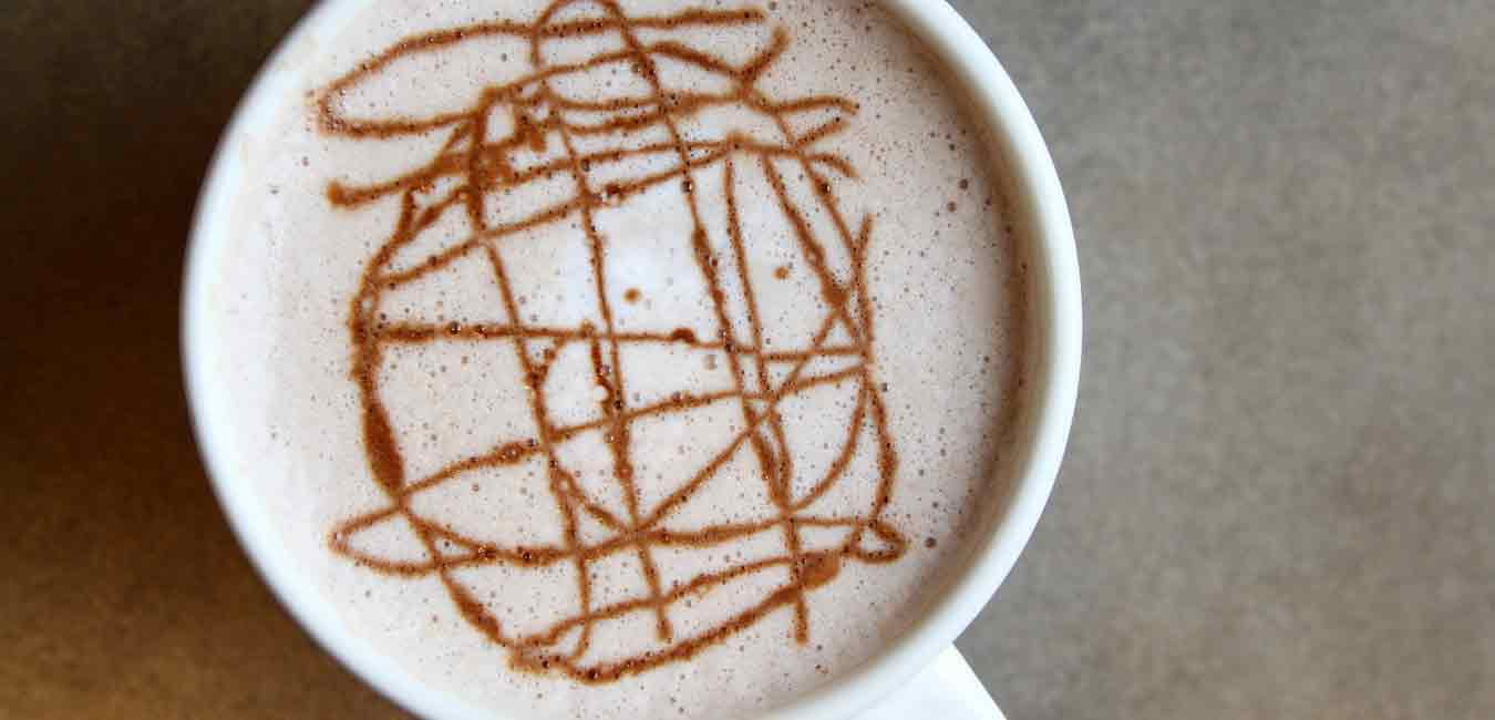 Cup of hot chocolate with chocolate swirls on top mindful eating