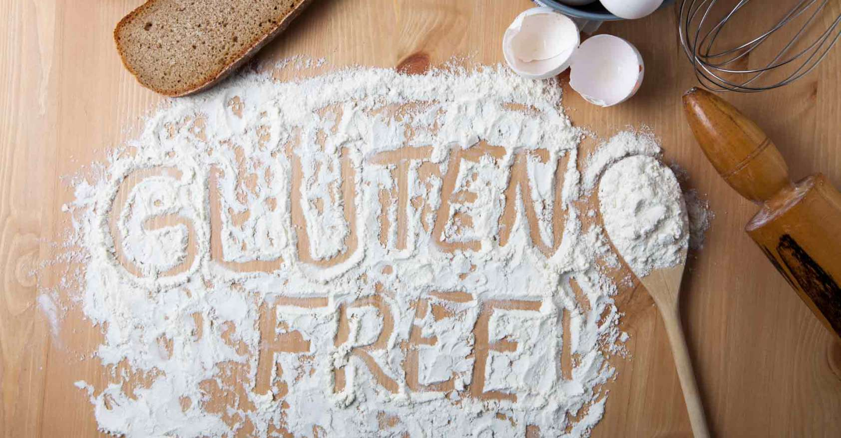 The words Gluten Free written in flour on a wooden table Gluten-free Watchdog