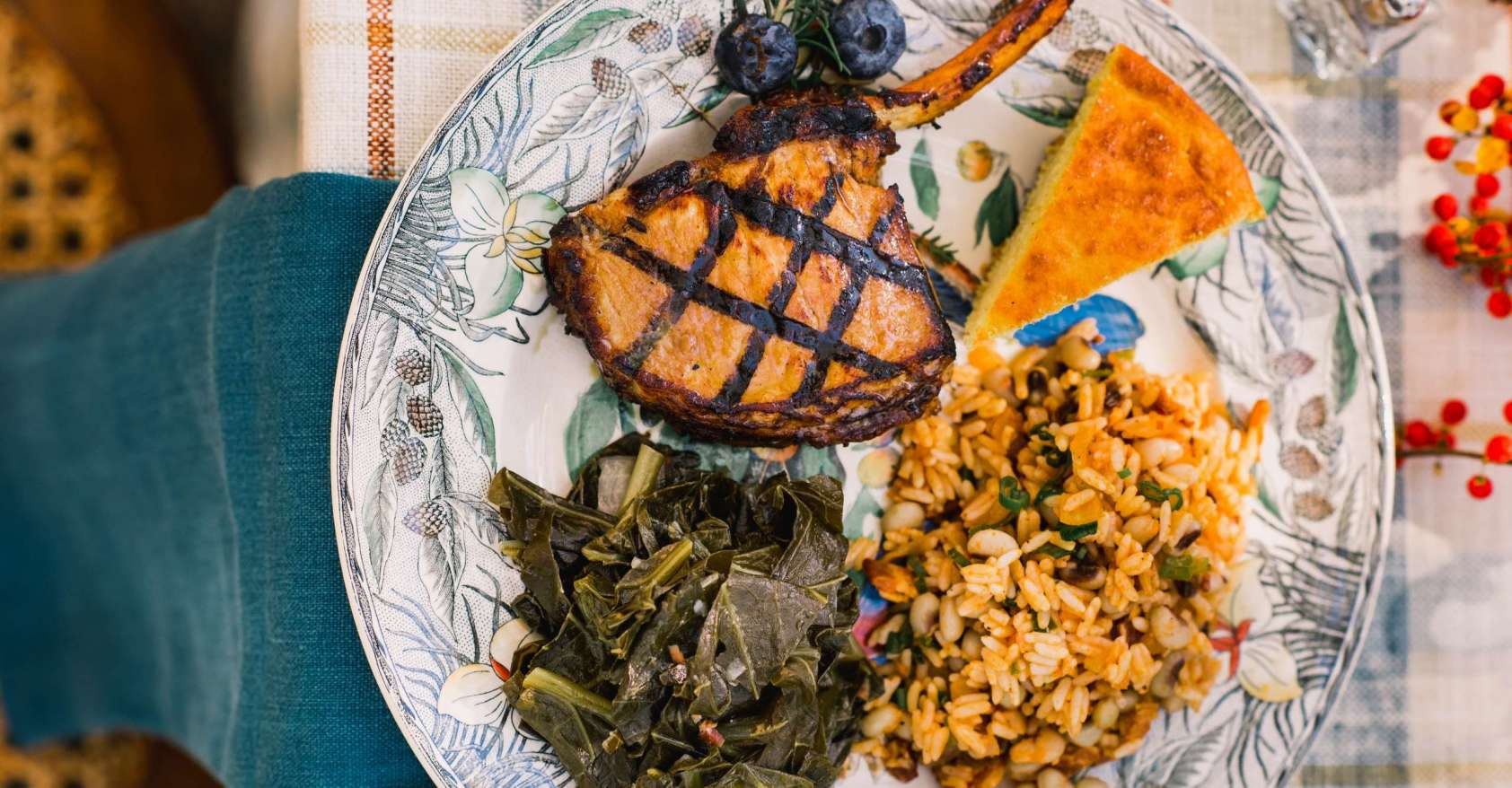 picture of beautiful Coastal Carolinas cuisine plated includes collards, golden rice, lamb shank and corn bread Salthouse Catering in Charleston, South Carolina