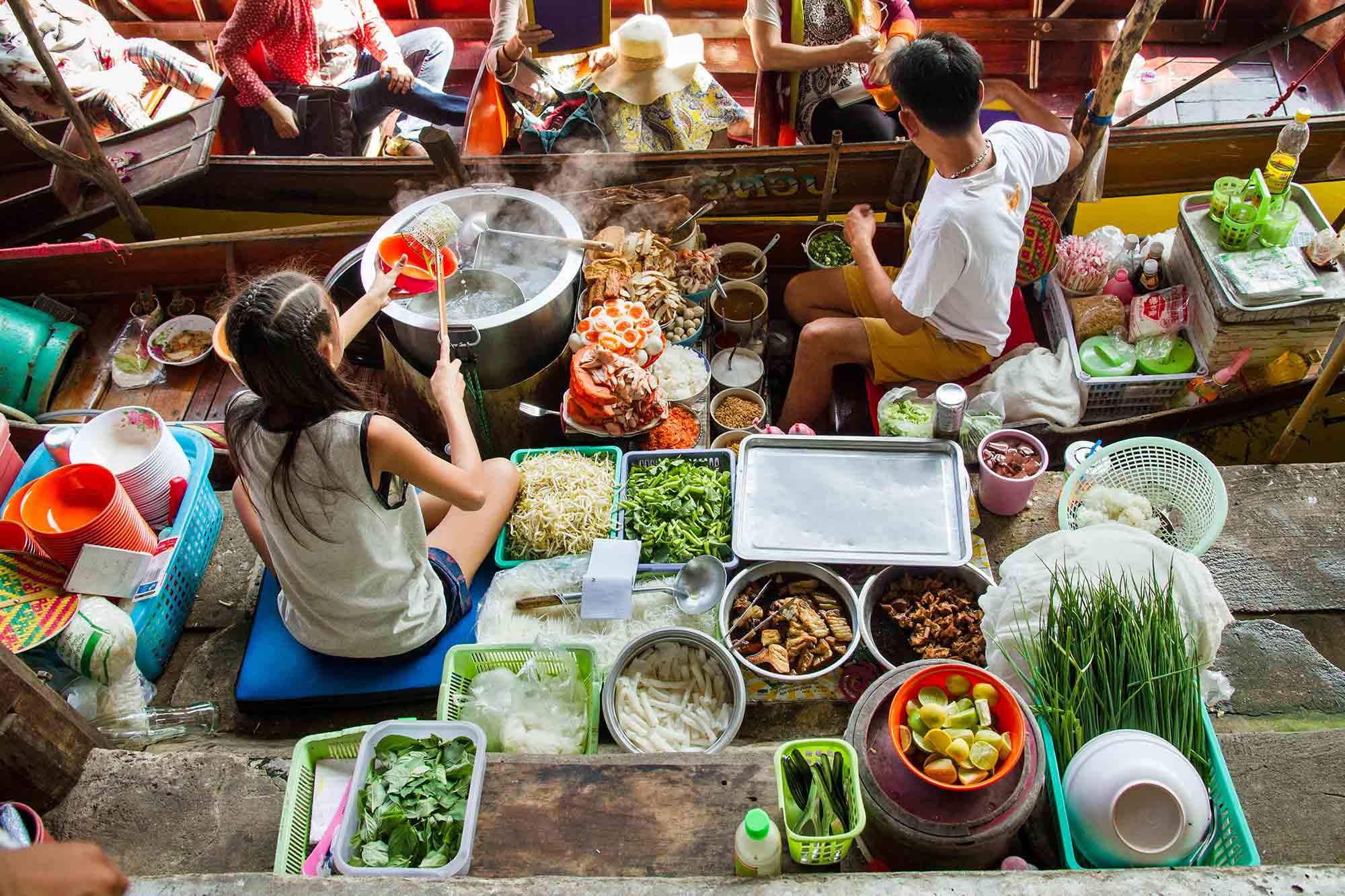 people making noodle soup which demonstrates their food culture