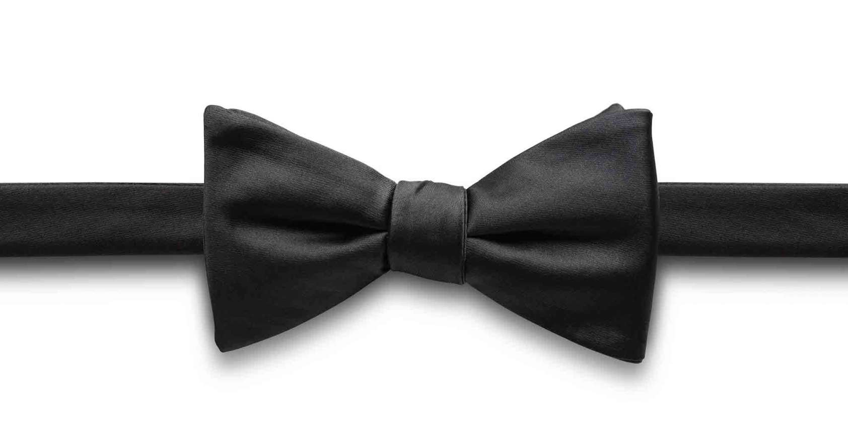 black bow tie on a white background to describe black tie service levels